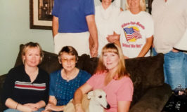 Fawn colored whippet dog in family photo.