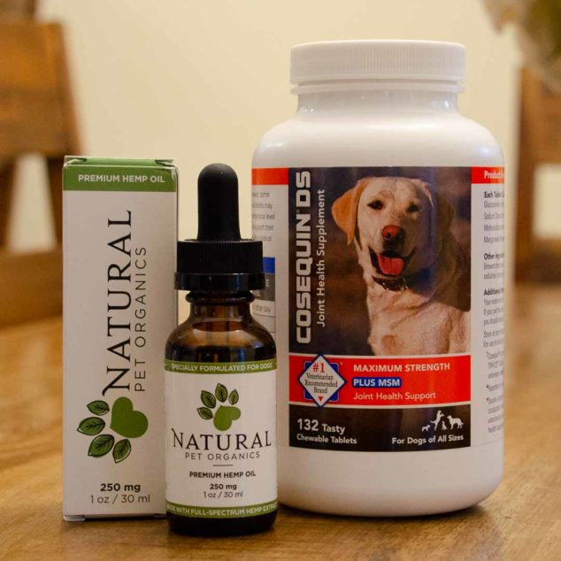 Bottles of cbd oil for dogs and cosequin supplement