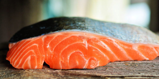 Piece of salmon on a wood surface