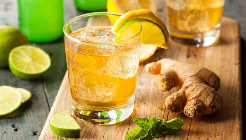 a glass of ginger ale and ginger root