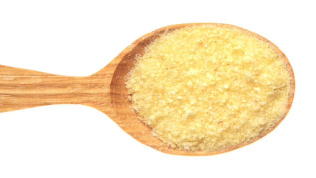 cornmeal in a wooden spoon