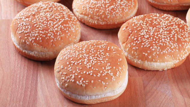 sesame seed buns on a table