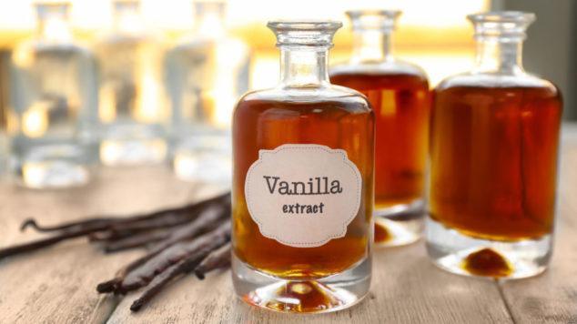 vanilla beans and bottles of vanilla extract