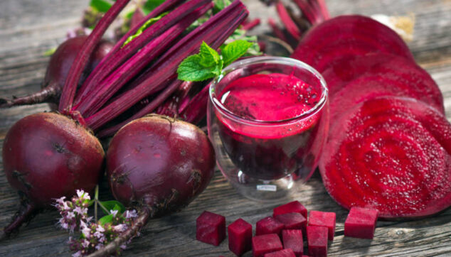 fresh red beets, beet juice, and beet slices