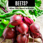 a bunch of red beets on a table