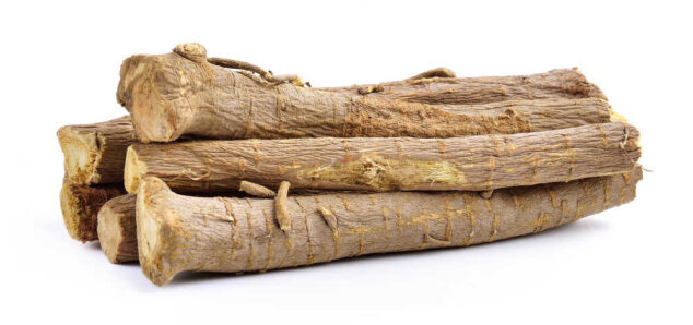 a pile of licorice root sticks