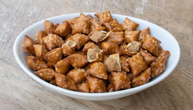 a bowl of peanut butter filled pretzels