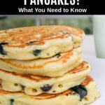 a stack of blueberry pancakes