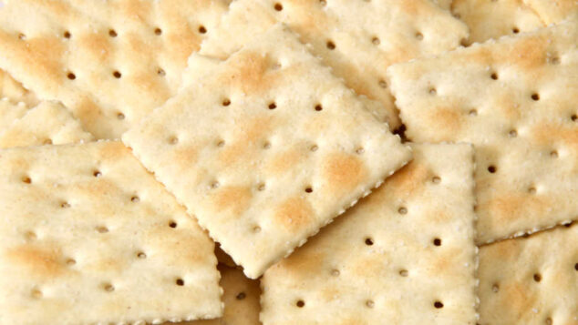 a pile of saltine crackers