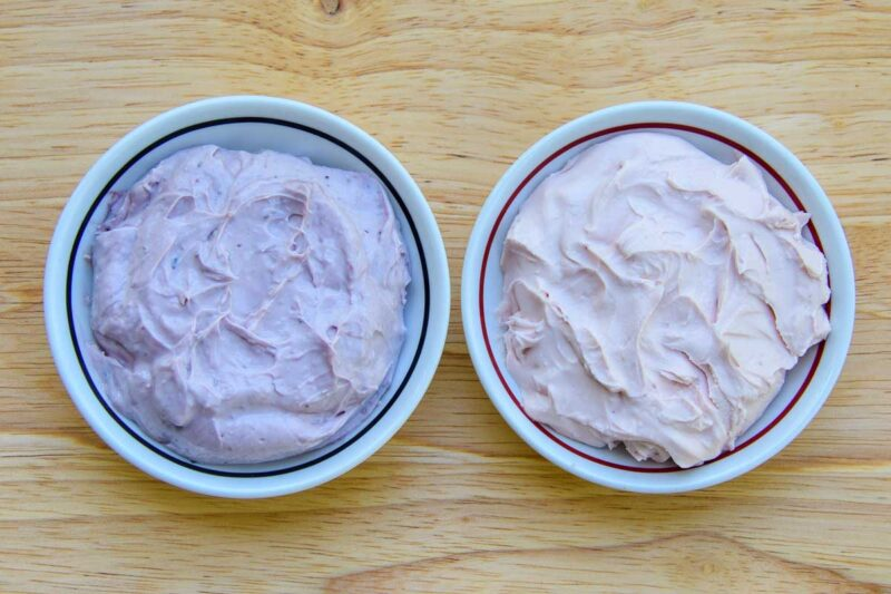 bowls of blueberry and strawberry cream cheese spread