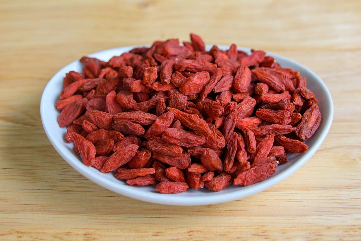 dried goji berries on a small plate