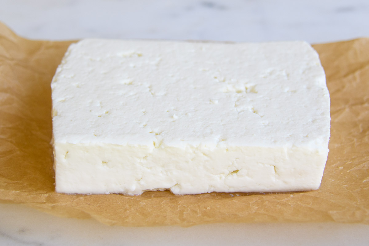 feta cheese block on parchment paper