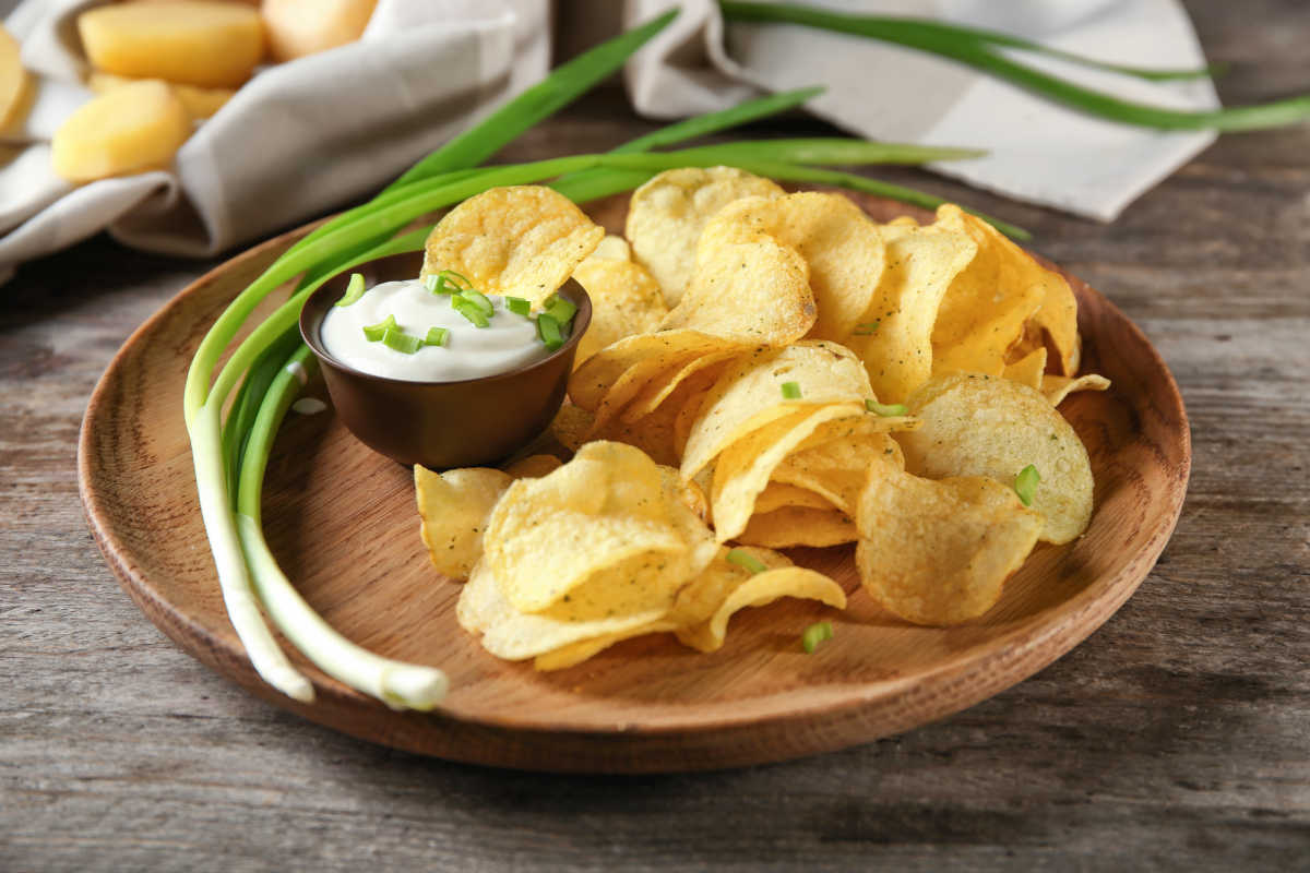 sour cream and onion potato chips on a plate