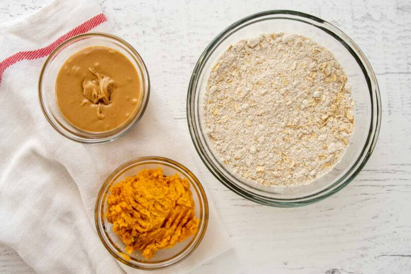 bowls of peanut butter, mashed sweet potato, and oatmeal