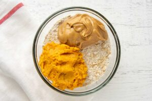 oatmeal, peanut butter, and mashed sweet potato in a bowl