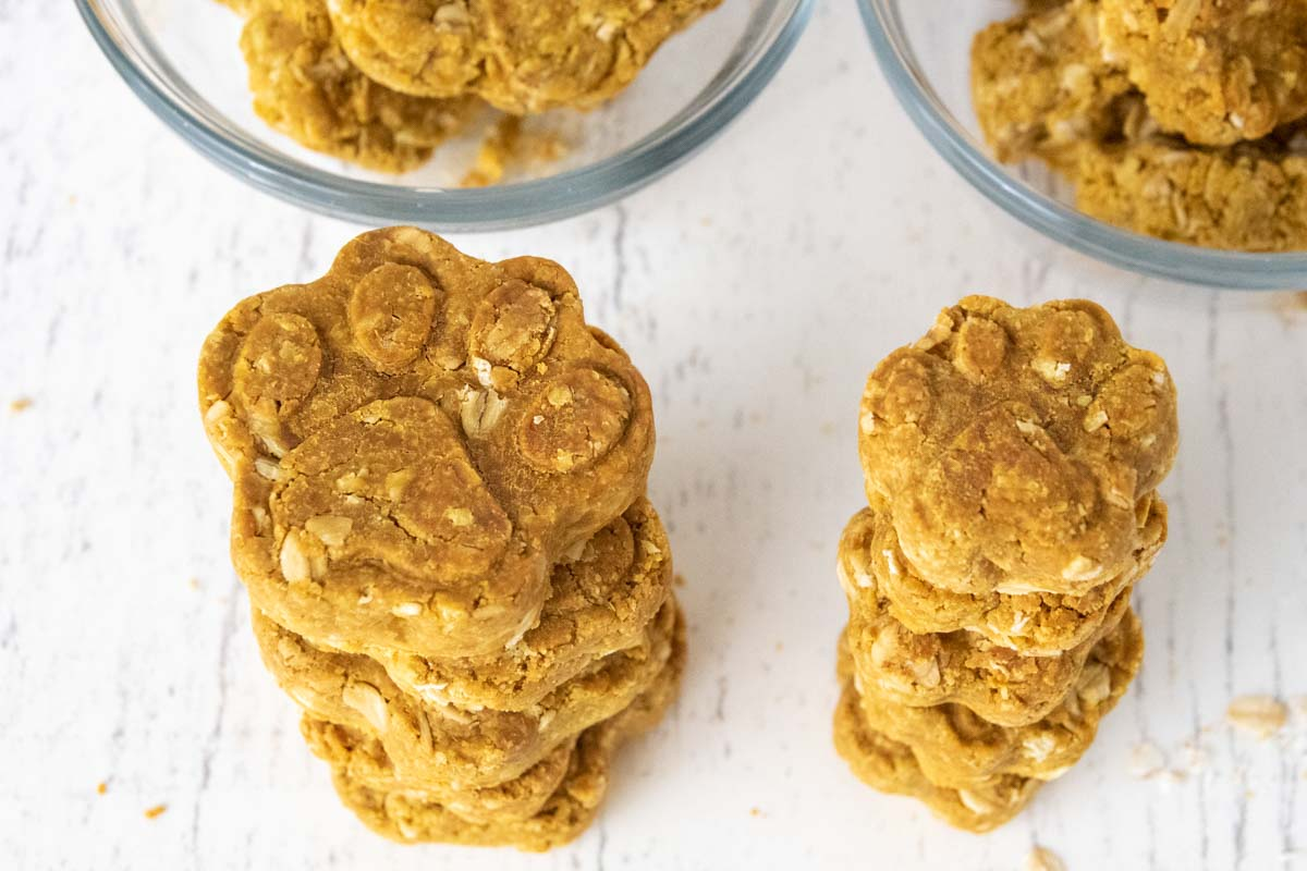 homemade 3 ingredient dog treats stacked and in bowls