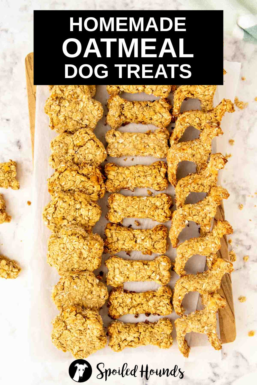 rows of apple oatmeal dog treats in three shapes on a platter