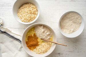 adding dry ingredients to make banana dog treats dough