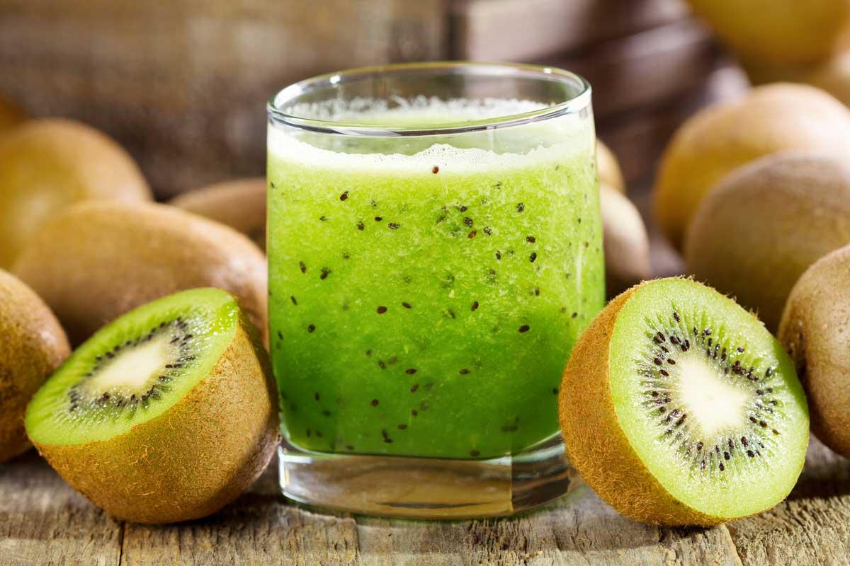 kiwi juice in a glass and kiwi fruit
