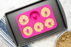 dog donut dough in a donut pan