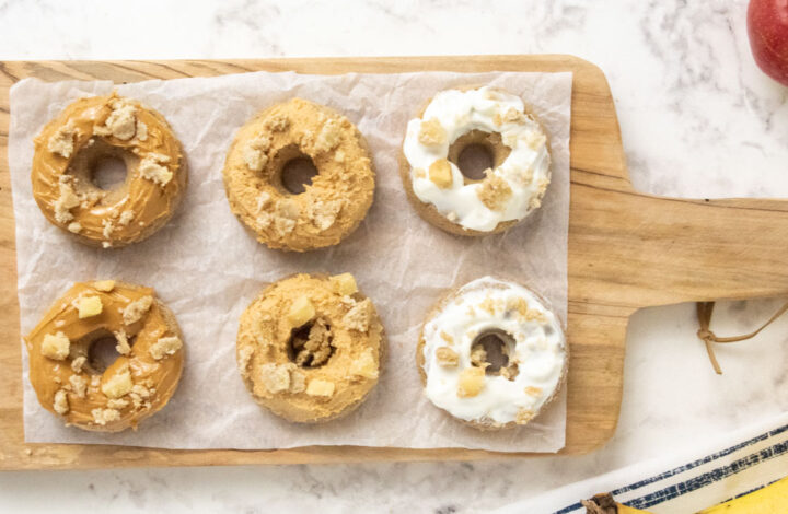 six homemade dog donuts with peanut butter and yogurt icing