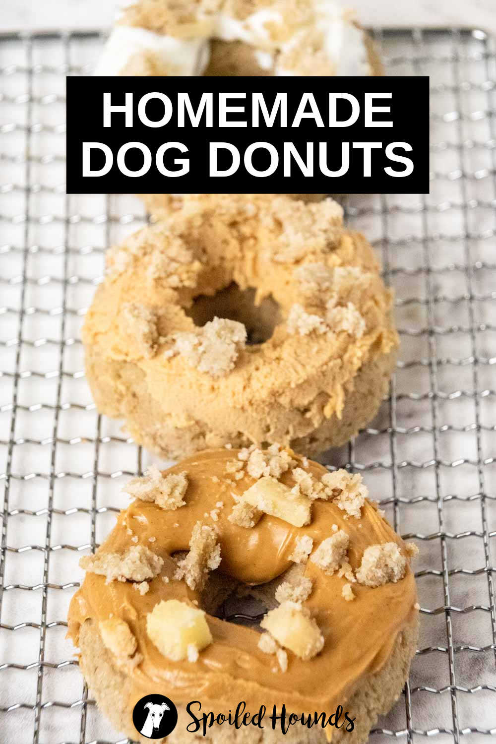 three homemade dog donuts on a wire rack