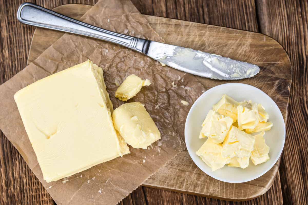 butter on parchment paper and in a bowl