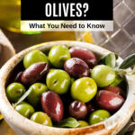 a bowl of green and black olives