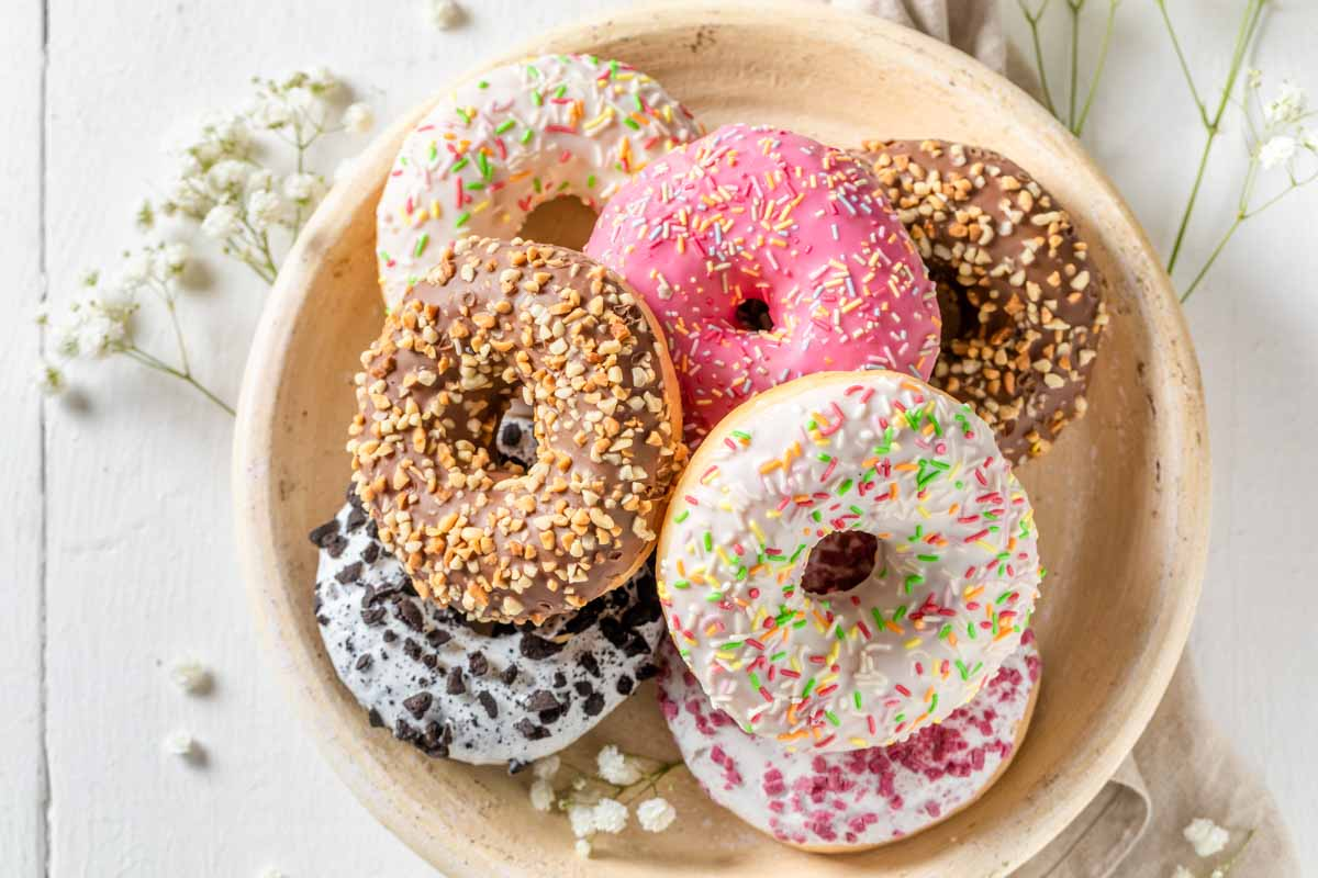 a plate of colorful donuts.