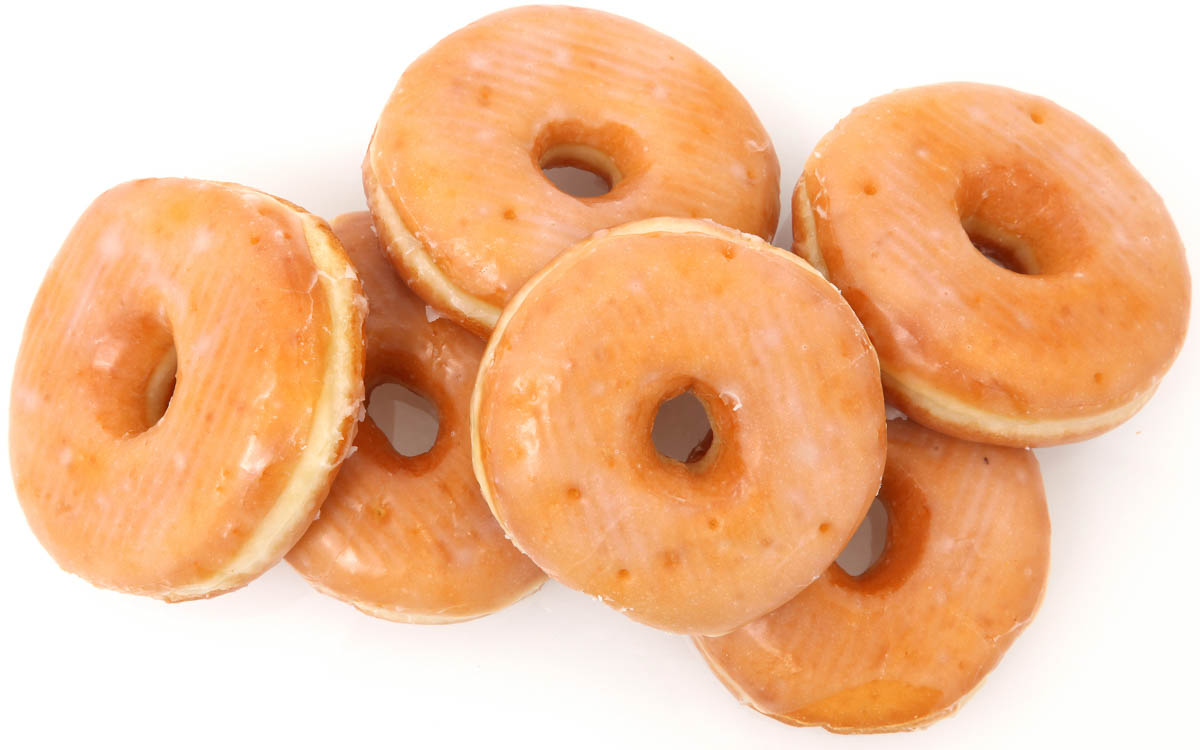 a pile of glazed donuts.