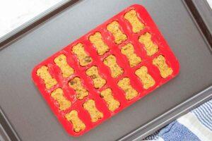 sweet potato dog treats dough in silicone mold before baking.