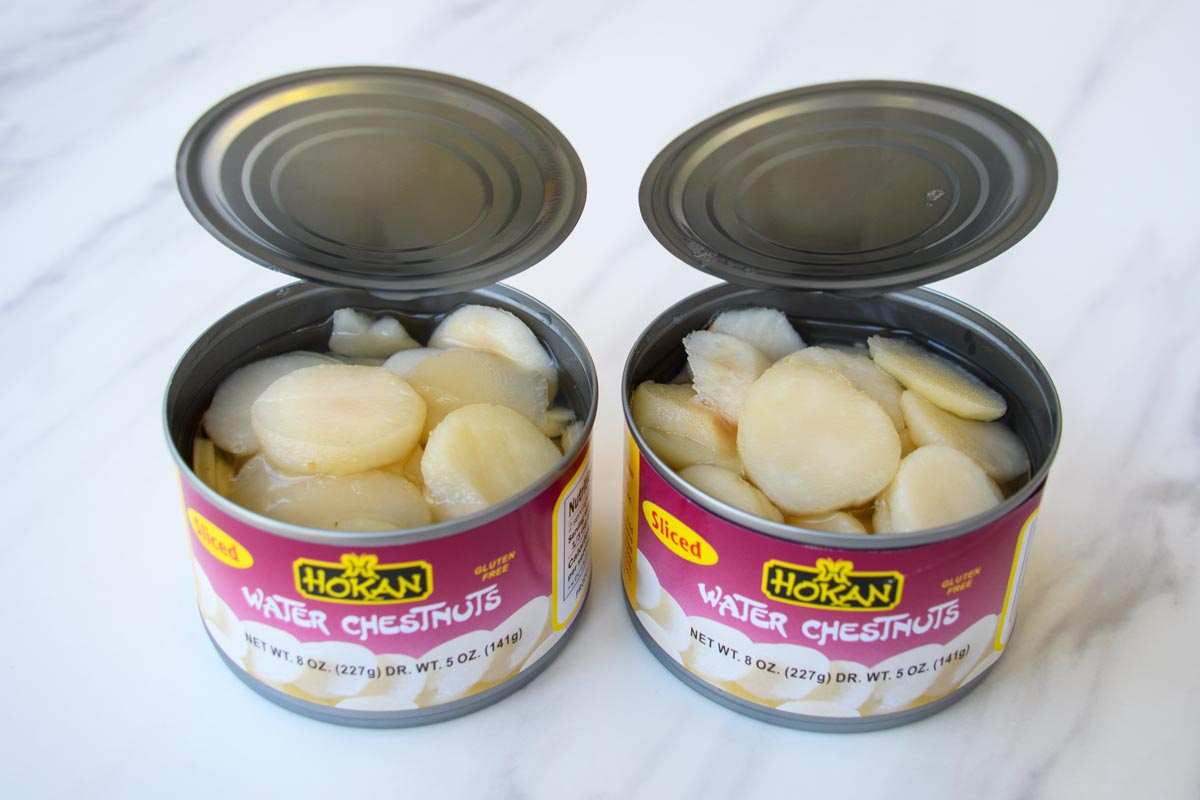 two opened cans of water chestnuts.