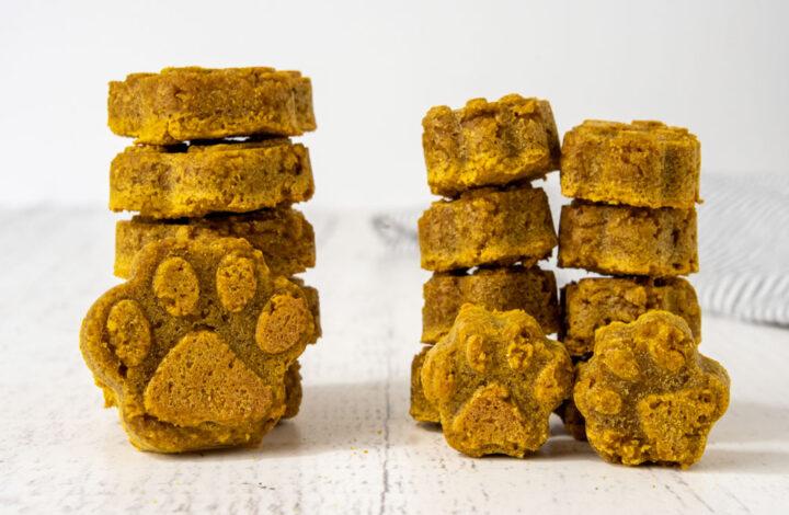 three stacks of homemade peanut butter pumpkin dog treats.