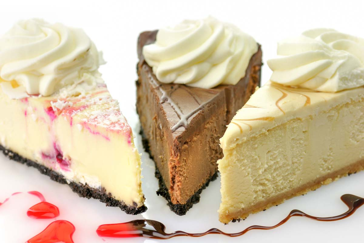3 slices of various cheesecake flavors.